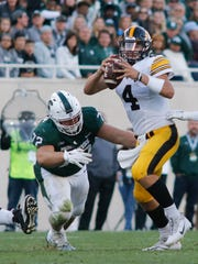 MSU DT Mike Panasiuk moves in to tackle Iowa QB Nate