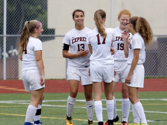 Kenda Oldroyd (13) shares a moment with teammates earlier