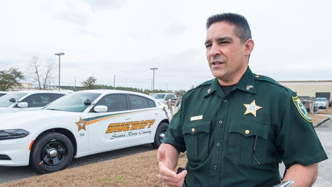 Public Information Officer Sgt. Rich Aloy talks about the 57 new vehicles at the Santa Rosa County Sheriff's Office in Milton on Thursday, February 1, 2018.  The vehicles which were purchased as a result of local option sales tax money will soon be hitting the streets.