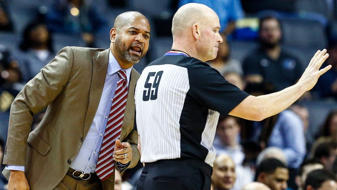 Memphis Grizzlies head coach J.B. Bickerstaff (left) disputes a foul call with official Gary Zielinski during first quarter action Utah Jazz at the FedExForum in Memphis, Tenn., Wednesday, February 7, 2018.