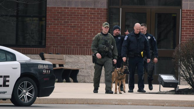 K-9 units from the Lancaster County Sheriff's Office leave Eastern York Middle School after reports of a bomb threat at one of the schools in the district.