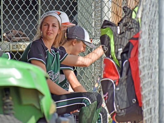 James Buchanan's Lizzie Pittman hangs out in the dugout during a non-league softball game in Mercersburg on Wednesday, May 10, 2017. James Buchanan won 3-1.