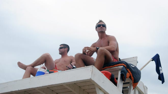 Bethany Beach Patrol lieutenants Matt Farlow, left, and Christian Sears keep an eye on the beach after Aug. 7-9 saw 72 rescues due to rough surf.