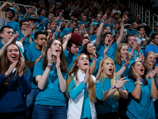 Michigan State students wearing teal-colored T-shirts