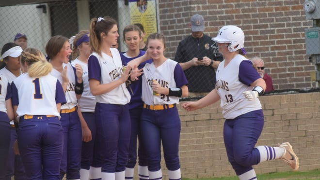 Alexandria Senior High School's Cendall Barton (13, right) is congratulated by teammates at home plate after hitting a 3-run homerun against Pineville High School during a 2018 game.