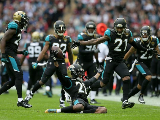 Jacksonville Jaguars cornerback Jalen Ramsey (20) celebrates after intercepting a pass against the Baltimore Ravens during the second half of an NFL football game at Wembley Stadium in London, Sunday Sept. 24, 2017. (AP Photo/Tim Ireland)