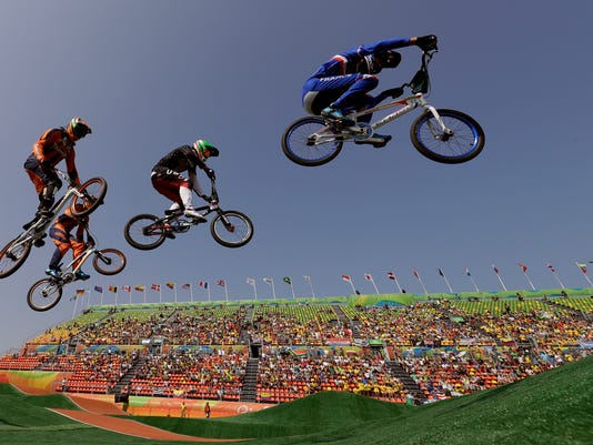Cyclists, from right, Joris Daudet of France, Nicholas Long of the United States, Niek Kimmann of the Netherlands and Jelle van Gorkom of the Netherlands compete in the BMX cycling quarterfinals during the 2016 Summer Olympics in Rio de Janeiro, Brazil, Thursday, Aug. 18, 2016. (AP Photo/John Locher)