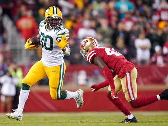 November 24, 2019; Santa Clara, CA, USA; Green Bay Packers running back Jamaal Williams (30) runs against San Francisco 49ers defensive back Emmanuel Moseley (41) during the third quarter at Levi's Stadium. Mandatory Credit: Kyle Terada-USA TODAY Sports