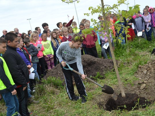 Every fifth-grade student shoveled dirt onto the newly planted Hackberry tree during the Arbor Day Celebration. Mayor Ken Harsanje told them they can one day return to the school and say they planted the first tree.