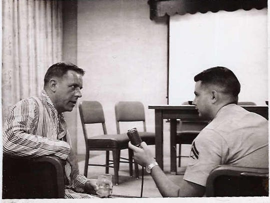 Marine Cpl. Al Benn interviews a Navy pilot who was