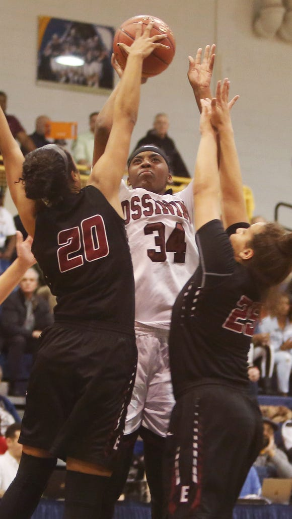 Ossining's Kailah Harris (34) puts up a shot in front of Elmira's Zaria DeMember-Shaze (20) and Mariah Gonzalez (25) during the girls basketball regional championship game at Pace University in Pleasantville March 9, 2018. Ossining won the game 90-78.