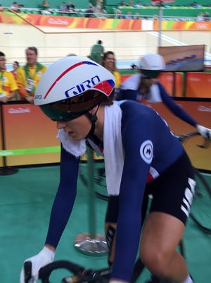 Chloe Dygert passes through the mixed zone, moments after she and her U.S. teammates set a world record in team pursuit;