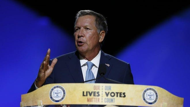 Ohio Gov. John Kasich speaks Sunday night to delegates at the NAACP national convention at the Duke Energy Convention Center.