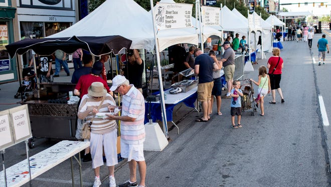 People browse tents featuring food from local restaurants during Taste of Port Huron Thursday, July 15, 2016 at Blue Water Fest in downtown Port Huron.