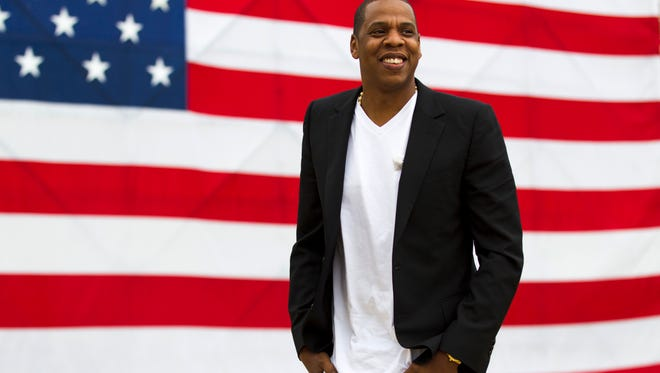 Jay-Z smiles after a news conference at Philadelphia's Museum of Art .