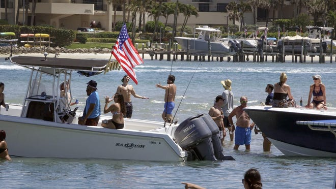 Despite authorities recommending people socially distance to stem the spread of COVID-19, on March 22 boaters congregated on Tequesta Sandbar. Shortly thereafter, Palm Beach County closed all ramps and marinas to recreational boating, so that large groups couldn't gather for parties on sandbars.