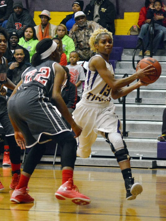 ANI Marksville Richwood Marksville's My'Sherle Johnson (13, right) drives against Richwood's Shay Thomas (32, left) Thursday, Feb. 26, 2015. -Melinda Martinez/mmartinez@thetowntalk.com The Town Talk Gannett