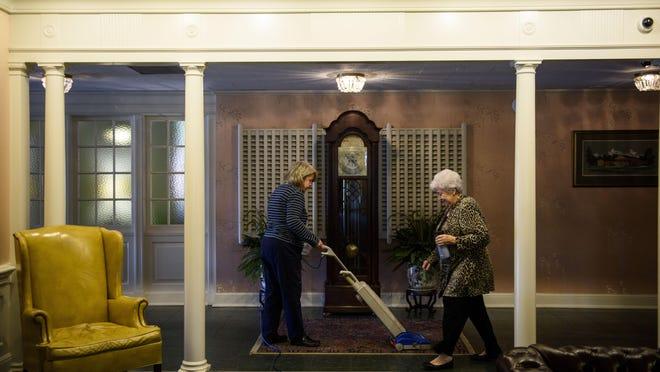 Employees work at Jernigan-Warren Funeral Home in Fayetteville.