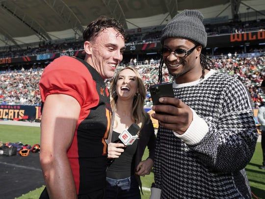Los Angeles Wildcats receiver and former Westlake High star Nelson Spruce (left) talks with former L.A. Rams teammate Todd Gurley (right) as ESPN sideline reporter Molly McGrath looks on during Sunday's XFL game in Carson.