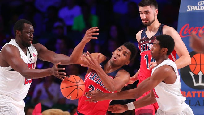 Nov 23, 2017;  Paradise Island, BAHAMAS; Arizona Wildcats guard Allonzo Trier (35) and SMU Mustangs forward Akoy Agau (23) go for the ball during the first half in the 2017 Battle 4 Atlantis in Imperial Arena at the Atlantis Resort. Mandatory Credit: Kevin Jairaj-USA TODAY Sports