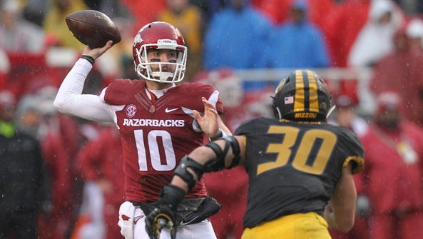 Arkansas quarterback Brandon Allen (10) passes during