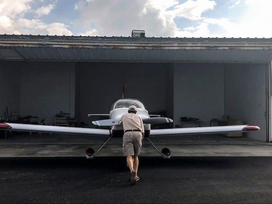 Tom puts his plane back in it's hanger. Take flight