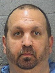 A booking photo of  Craig Stephen Hicks, 46, who was