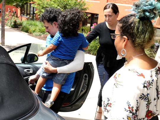 Ever Reyes Mejia of Honduras puts his 3-year-old son into a car shortly after his reunification with him after being separated for three months. The reunion happened inside the U.S. Customs and Immigration Enforcement in Grand Rapids on Tuesday, July 10, 2018.