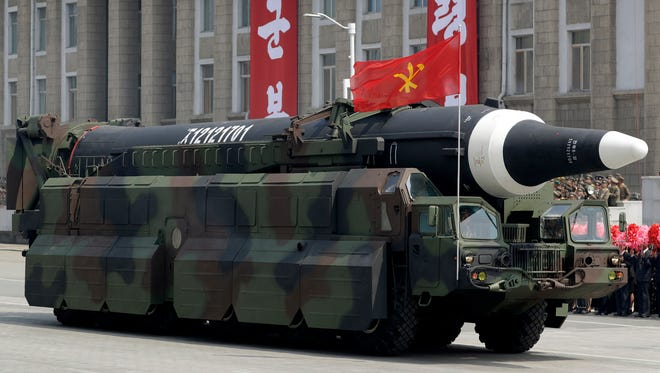 """In this April 15, 2017, file photo, a missile that analysts believe could be the North Korean Hwasong-12 is paraded across Kim Il Sung Square in Pyongyang. The country's official Korean Central News Agency said the missile fired Sunday, May 14, 2017, was a Hwasong-12 """"capable of carrying a large-size heavy nuclear warhead."""" North Korea said Wednesday that it was examining operational plans for attacking Guam, an angry reaction to U.N. punishment for recent North Korean intercontinental ballistic missile tests and a U.S. suggestion about preparations for possible preventive attacks to stop the North's nuclear weapons program."""