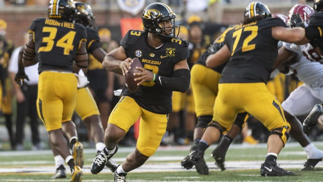 Missouri quarterback Shawn Robinson (3) looks for a receiver during a game against Alabama on Saturday at Faurot Field.