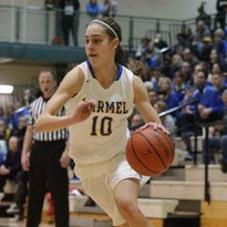 Carmel's Amy Dilk, shown here versus Fishers Feb. 5, scored 18 points on Saturday to lead the Greyhounds past Westfield in the sectional title game.