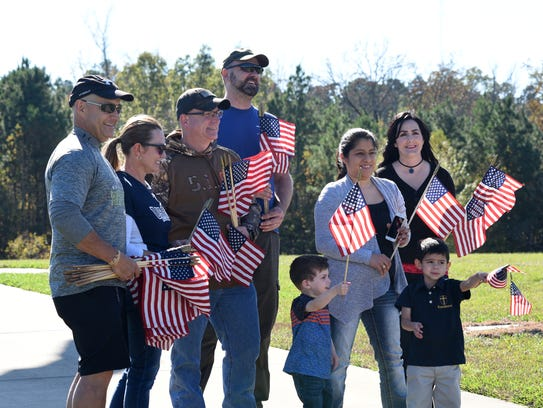 People celebrate our veterans Friday by placing flags