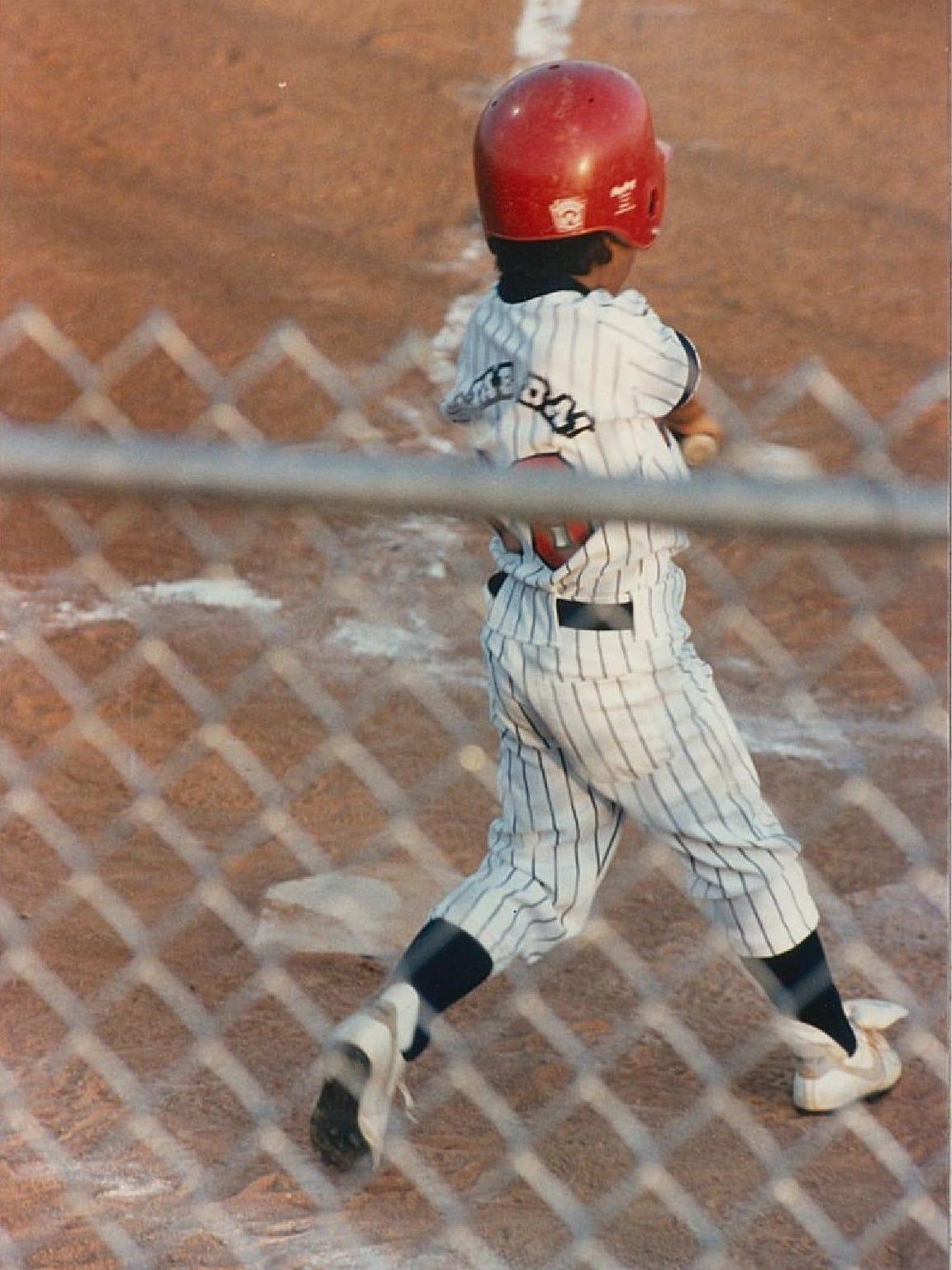 A seven-year-old Tony Jaramillo takes an at-bat in