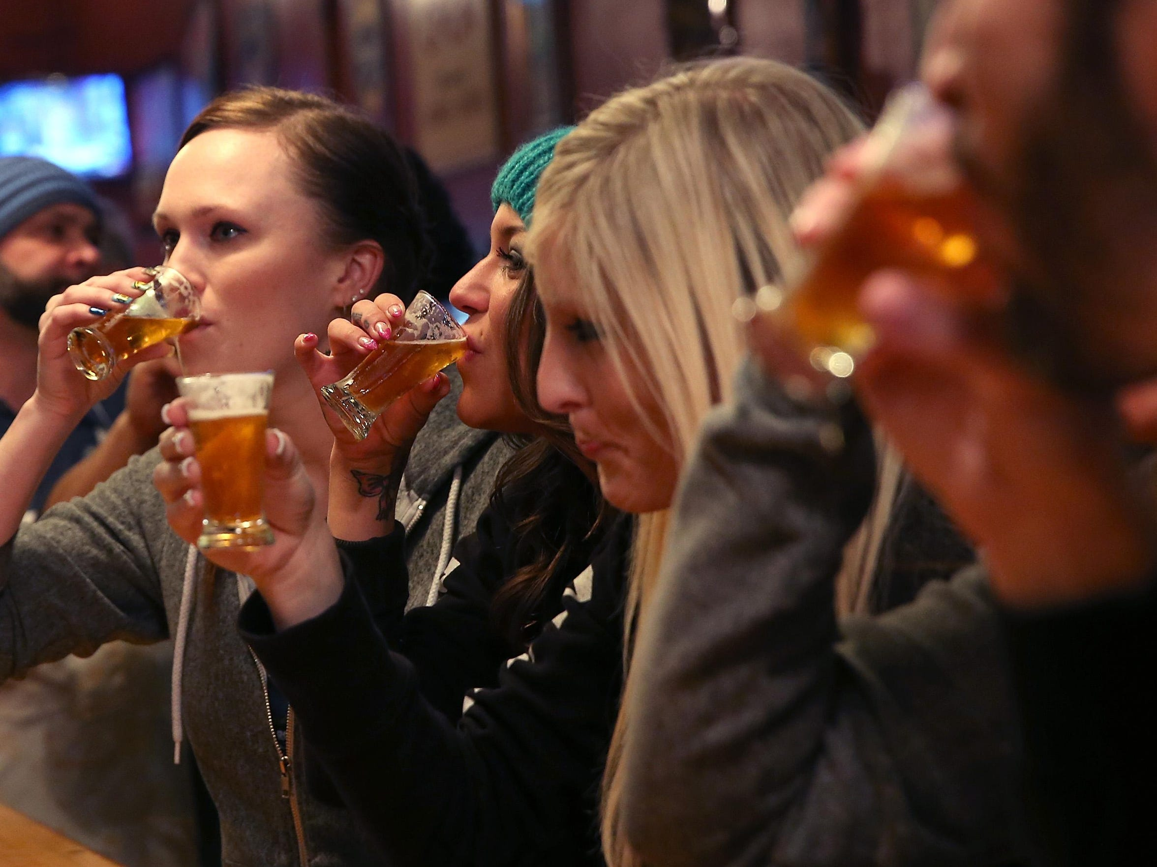 Russian River Brewing Co. staff members drink the newly