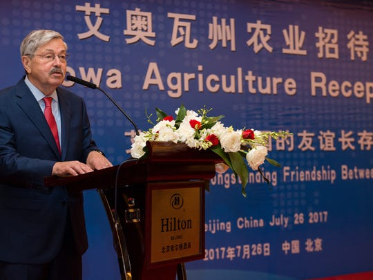 Iowa's former governor, Terry Branstad, now the U.S. ambassador to China, talks with Iowa soybean growers.