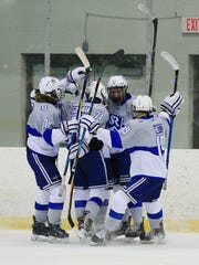 The Salem Rocks celebrate one of three goals in the first period Saturday against Trenton.