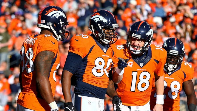 Peyton Manning (18), Julius Thomas (80) and Demaryius Thomas (88) were among nine Broncos selected to the Pro Bwol.