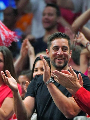 Green Bay Packers quarterback Aaron Rodgers cheers during the second half of the NCAA basketball regional final between Wisconsin and Arizona in Los Angeles last month.