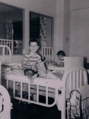 Orville Kock of Carroll, shown here at age 5 in 1952, sits inside a polio quarantine in Des Moines during what was the height of the epidemic in Iowa and nationwide.