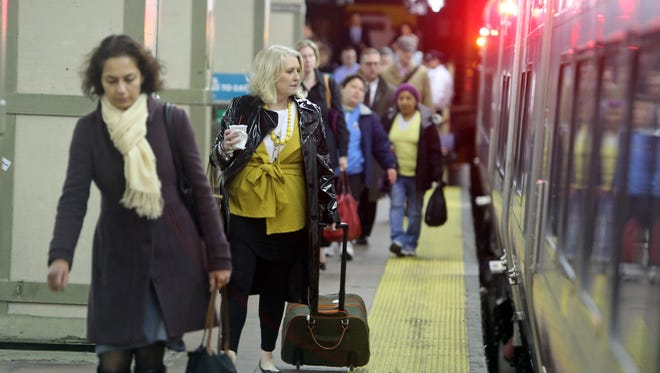 Commuters board a New Haven Line train at Grand Central Station April 8, 2014.