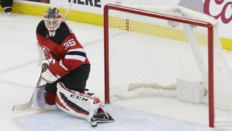 Devils goaltender Cory Schneider watches the puck go by him on a shot by Nikita Kucherov of Tampa Bay. It was the Lightning's second goal of the first period during Game 4 of the opening round of the Stanley Cup Playoffs on Wednesday, April 18, 2018 at Prudential Center, Newark.