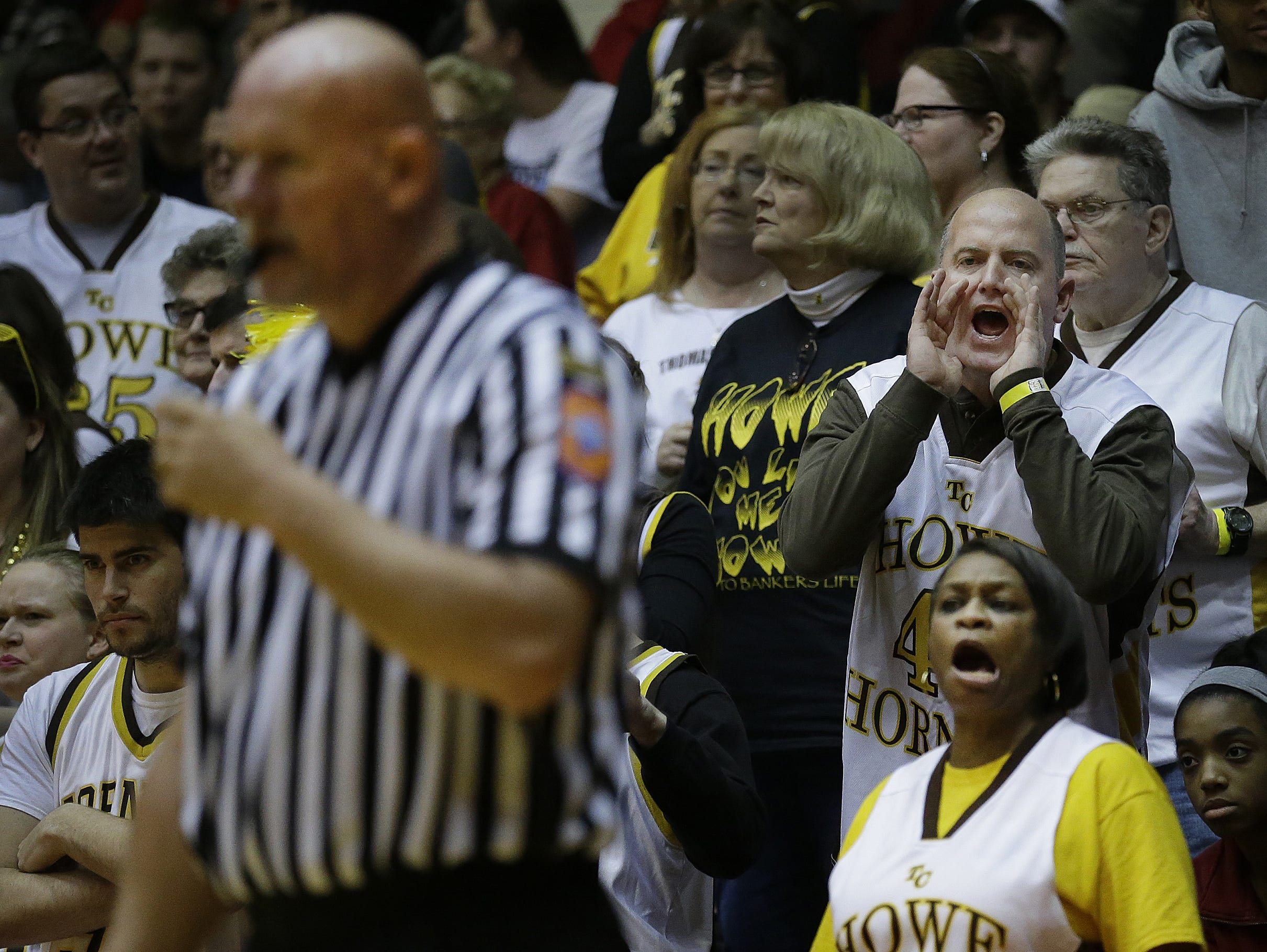 Fans from Howe give their opinions to the IHSAA officials in the second half of their Class 2A semistate game, March 19, 2016.