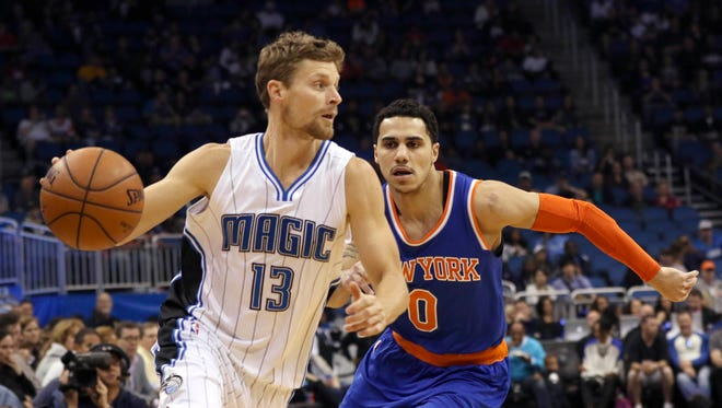 Feb 11, 2015; Orlando, FL, USA; Orlando Magic guard Luke Ridnour (13) drives past New York Knicks guard Shane Larkin (0) during the first quarter at Amway Center. Mandatory Credit: Reinhold Matay-USA TODAY Sports