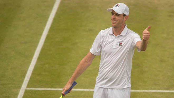 Sam Querrey (USA) celebrates match point during his match against Nicolas Mahut during Wimbledon on July 4.