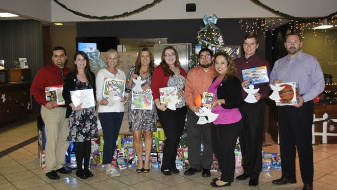 ValueBank Texas Southside employees and Foster Angels of South Texas representatives gathered Tuesday to distribute gifts collected for 15 foster children.