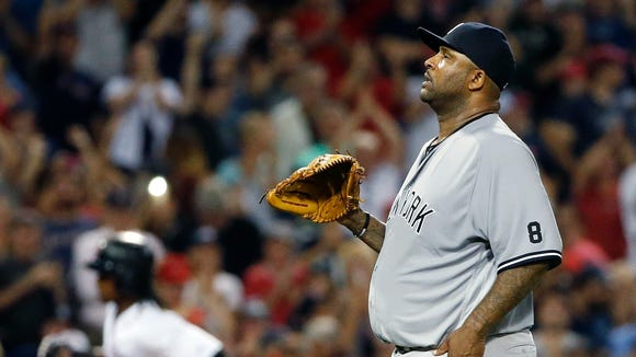 New York Yankees' CC Sabathia stands on the mound after