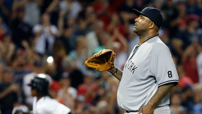 New York Yankees' CC Sabathia stands on the mound after giving a three-run home run to Boston Red Sox's Hanley Ramirez, left, during the fifth inning of a baseball game in Boston, Sunday, Sept. 18, 2016.