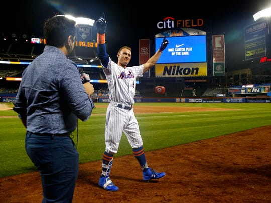 Jul 11, 2018; New York City, NY, USA; New York Mets center fielder Brandon Nimmo (9) celebrates after hitting a three run home run in the tenth inning to defeat the Philadelphia Phillies 3-0 at Citi Field.