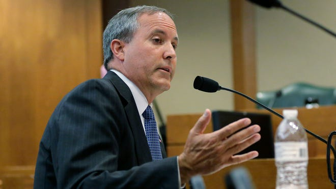 In this Wednesday, July 29, 2015, file photo, Texas Attorney General Ken Paxton speaks during a hearing in Austin, Texas. On Monday, Nov. 2, 2015, Paxton's attorneys asked a judge to throw out the securities fraud charges against him.