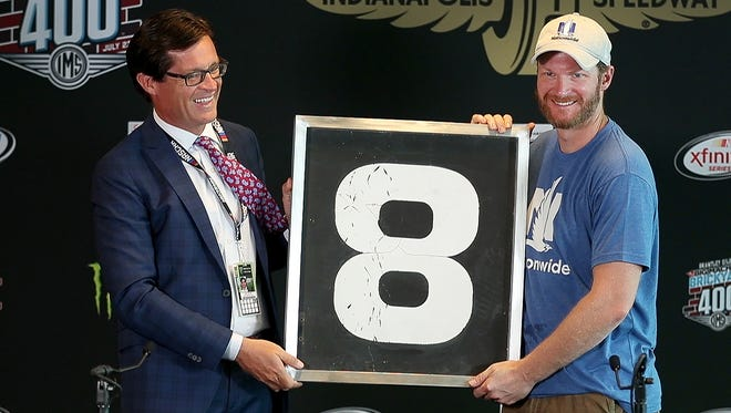 Indianapolis Motor Speedway president Doug Boles presents Dale Earnhardt Jr. with the number 8 from old IMS scoring pylon Saturday, July 22, 2017, morning at the Indianapolis Motor Speedway. Earnhardt is retiring at the end of this NASCAR season.